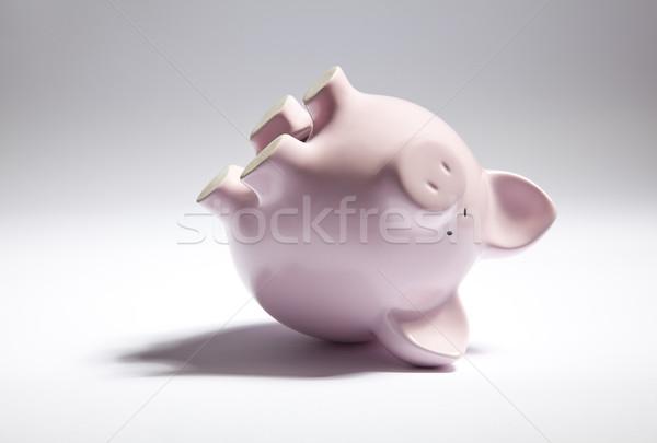 Rosa piggy bank de cabeça para baixo banco brinquedo porco Foto stock © sqback