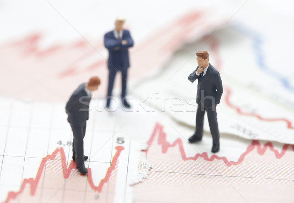 Stock photo: Financial crisis. Figures of businessman on financial charts