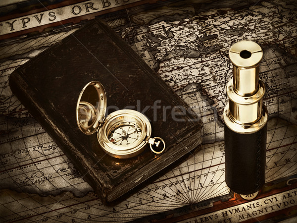 vintage telescope and compass at antique map Stock photo © SRNR