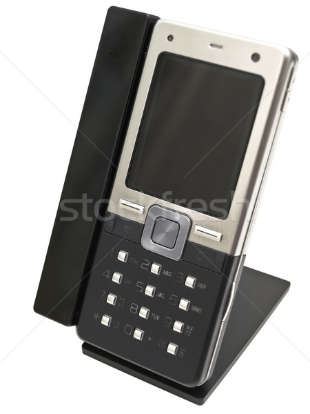 Mobile phone in holder against the white background Stock photo © SRNR