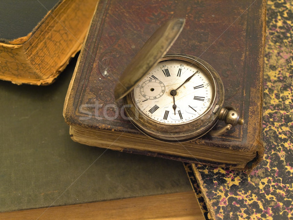 Heap of the old books and clock on it Stock photo © SRNR