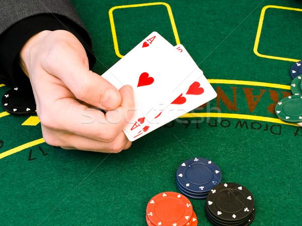 Cassino mão homem jogar tabela verde Foto stock © SRNR