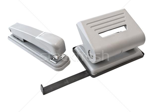 Hole puncher and stapler over the white background