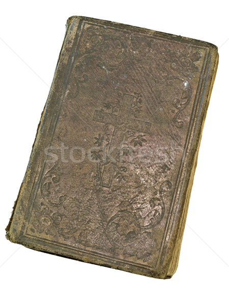 Stock photo: Old closed book at the white table