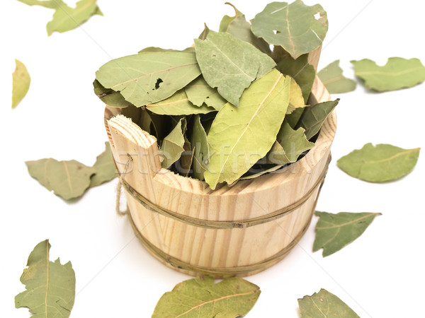 Wooden sauna vat and some bay leaves against white background Stock photo © SRNR