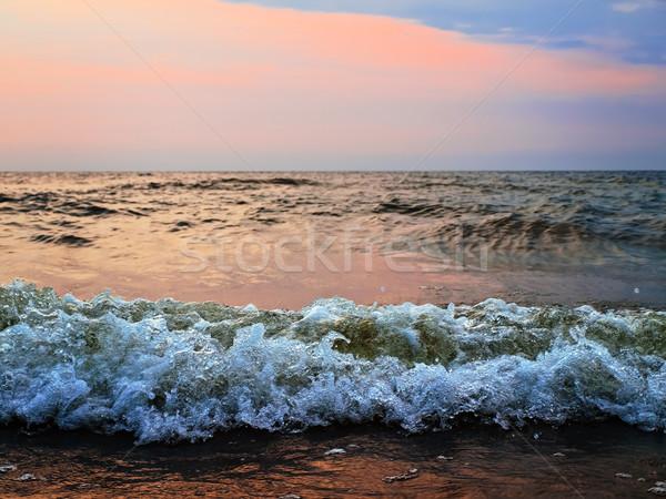 Coucher du soleil orageux mer vagues lumière été Photo stock © SRNR