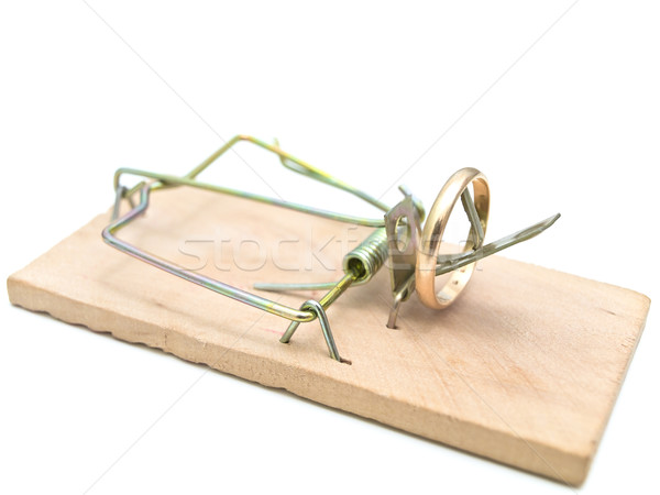 Single mousetrap with golden ring against the white background  Stock photo © SRNR