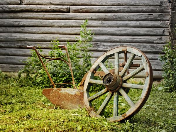 Köy tekerlek pulluk çim ahşap duvar Stok fotoğraf © SRNR
