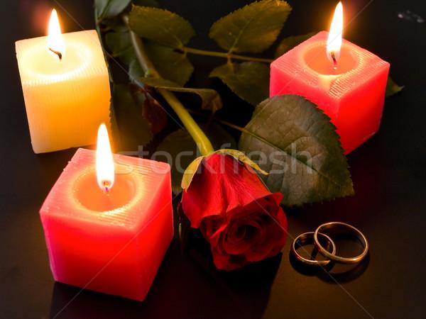 Stock fotó: Jegygyűrűk · rózsa · gyertyák · éjszaka · virág · esküvő