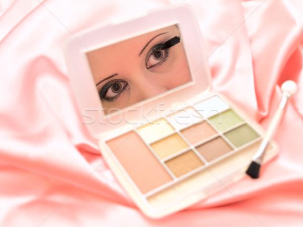 Women eyes reflection in small mirror   Stock photo © SRNR