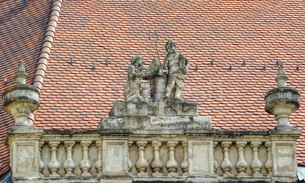 Escultura telhado casa edifício homem arte Foto stock © SRNR