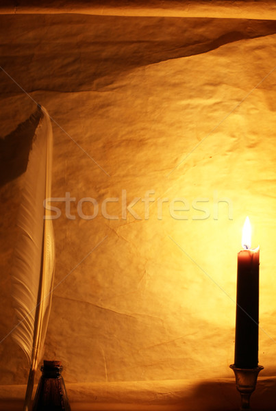 Paper, quill, & ink lit by candle Stock photo © SSilver
