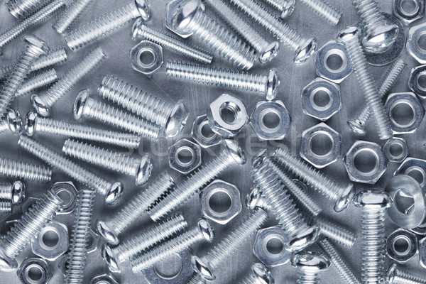Nuts and bolts background Stock photo © SSilver