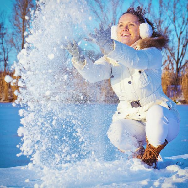 Kadın oynama kar genç kadın hava gülen Stok fotoğraf © Steevy84