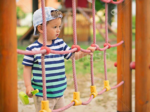 Genç çocuk küçük erkek oynama oyun alanı Stok fotoğraf © Steevy84