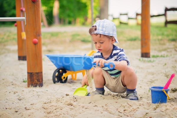 Kicsi fiú fiatal srác játszik játszótér nyáridő Stock fotó © Steevy84