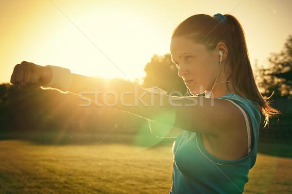 Spor gün batımı genç kadın oyun alanı gökyüzü çim Stok fotoğraf © Steevy84
