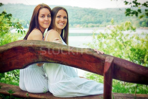Iki genç kadın oturma bank güzel Stok fotoğraf © Steevy84