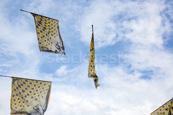 Traditional italian festival with flag throwers.Flags on the blu Stock photo © stefanoventuri