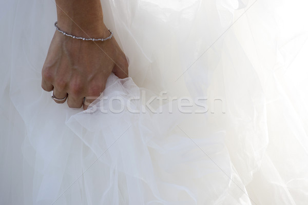 Closeup of a bride hand on wedding dress Stock photo © stefanoventuri