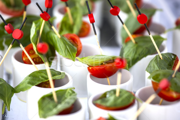 Stock photo: Finger food: cherry tomatoes, mozzarella and basil. Wedding star