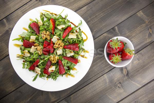 Spring salad with strawberries, rocket salad, parmesan cheese, w Stock photo © stefanoventuri