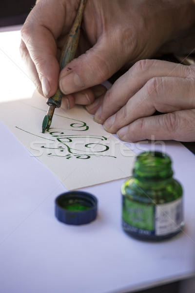 street painter writing a celtic name with green pen Stock photo © stefanoventuri