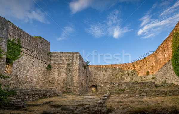 Old fortress walls and blue sky view Stock photo © Steffus