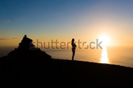 Romantic evening sunset at La Palma island with women's silhoette. Stock photo © Steffus