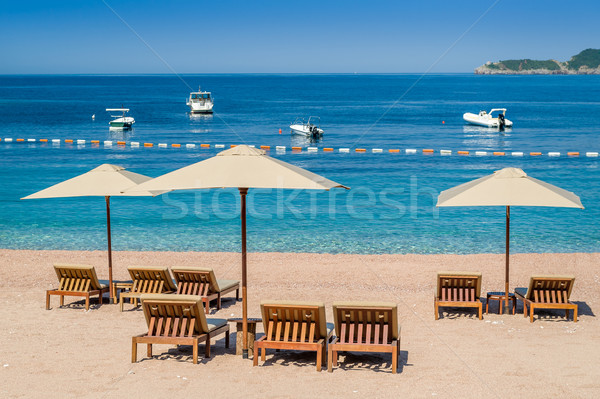 Sand beach with wooden furniture and perfect Adriatic sea Stock photo © Steffus