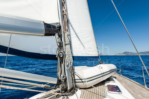 Stock photo: Sailing yacht going on her sails in calm weather