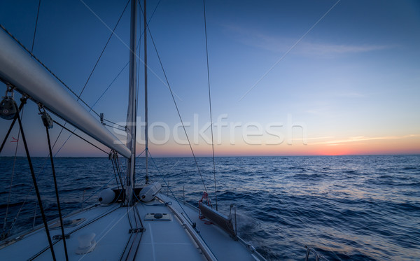 Sailing at sunset Stock photo © Steffus