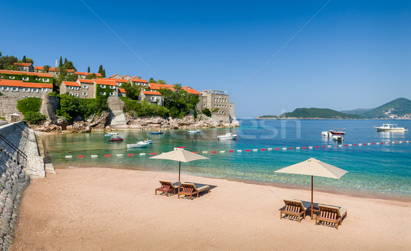 Adriatic sea luxury sand beach with chaise-longue chairs and umbrellas Stock photo © Steffus