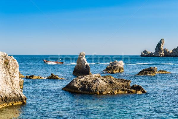 Speed boat and sharp rocks near Isola Bella Stock photo © Steffus