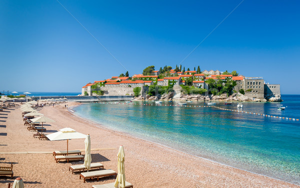 Sveti Stefan luxury sand beach with chaise-longue chairs and umbrellas Stock photo © Steffus