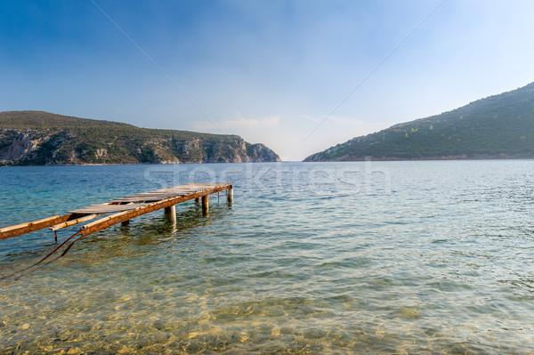 Starych molo podziale piękna przezroczysty wody Zdjęcia stock © Steffus