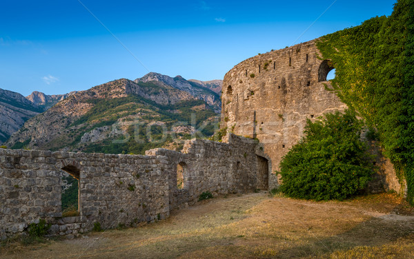 Old fortress walls and mountain range Stock photo © Steffus