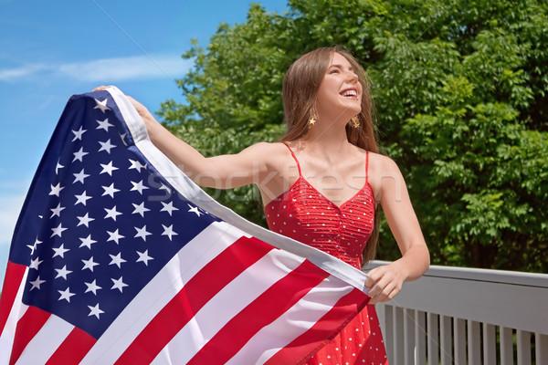 женщину американский флаг улыбка синий флаг Сток-фото © Stephanie_Zieber
