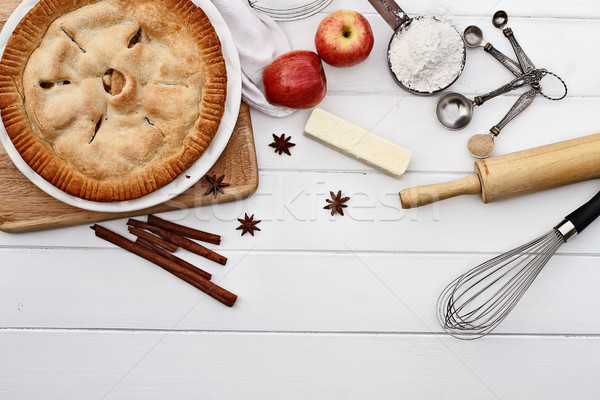 Apple Pie with Ingredients Over Wooden Table Top Stock photo © StephanieFrey