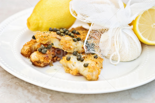 Fish Served With Lemons Tied in Cheesecloth Stock photo © StephanieFrey