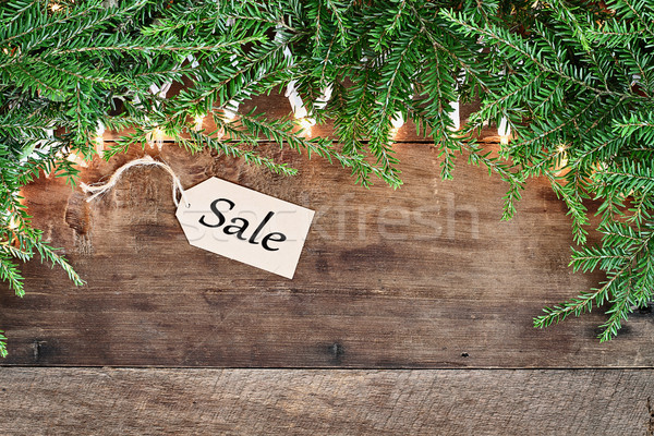 Pine Needles and Lights with Sales Tag over Wooden Background Stock photo © StephanieFrey