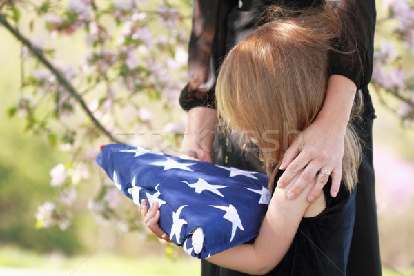 Child Holding a Parent's Folded American Flag Stock photo © StephanieFrey