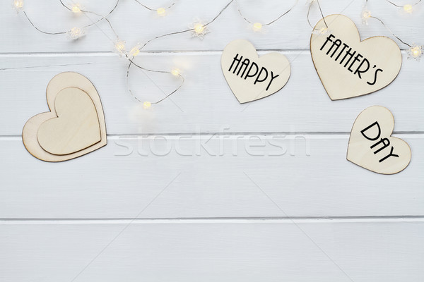 Happy Father's Day over Hearts with Fairy Lights Stock photo © StephanieFrey
