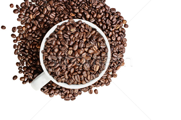 Isolated Coffee Beans Overflowing from a Cup Stock photo © StephanieFrey