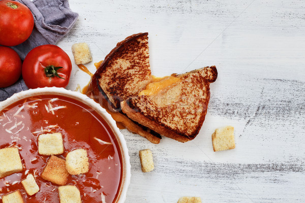 Tomato Soup garnished with Parmesan cheese and croutons Stock photo © StephanieFrey