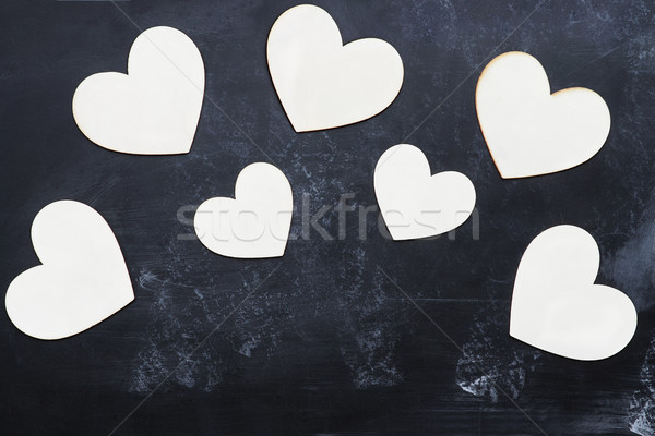 Wooden Cutout Valentine's Day Hearts over Blackboard Stock photo © StephanieFrey