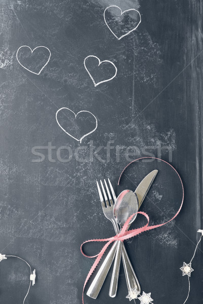 Faded Valentines Day Cutlery over Blackboard Stock photo © StephanieFrey