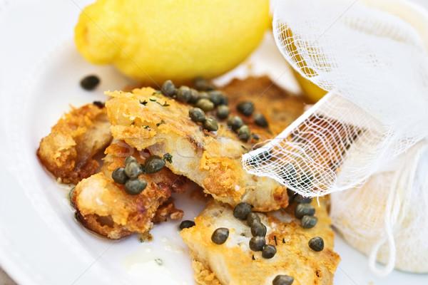 Peixe servido limões molho comida jantar Foto stock © StephanieFrey