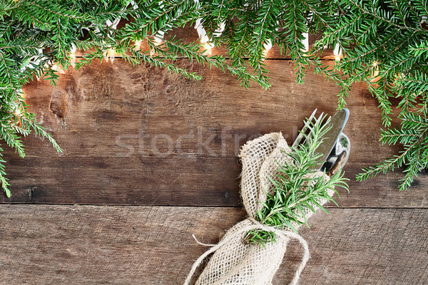 Pine Needles and Lights with Silverware over Wooden Background Stock photo © StephanieFrey
