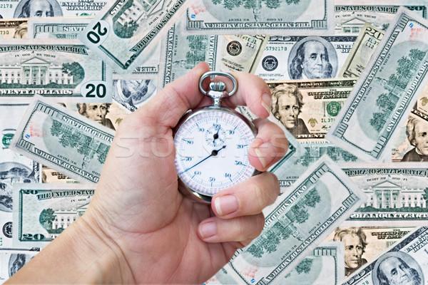 Kéz tart gyártás óra pénz nő Stock fotó © StephanieFrey